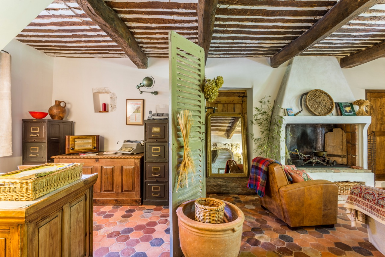 Study - From the dining room, a stone archway leads through to a study, again with original provençal ceiling, large fireplace and welcoming sofa as well as wireless high speed internet. The room opens onto the large terrace and lawn.