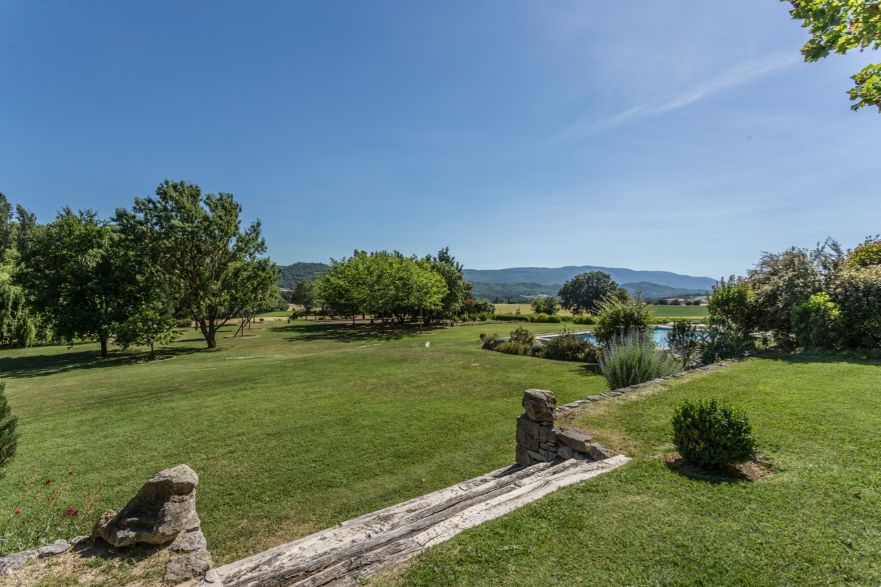 - ...or contemplate a stunning vista to the south and west which includes the mountain range of the Luberon and the perched village of Montjustin.