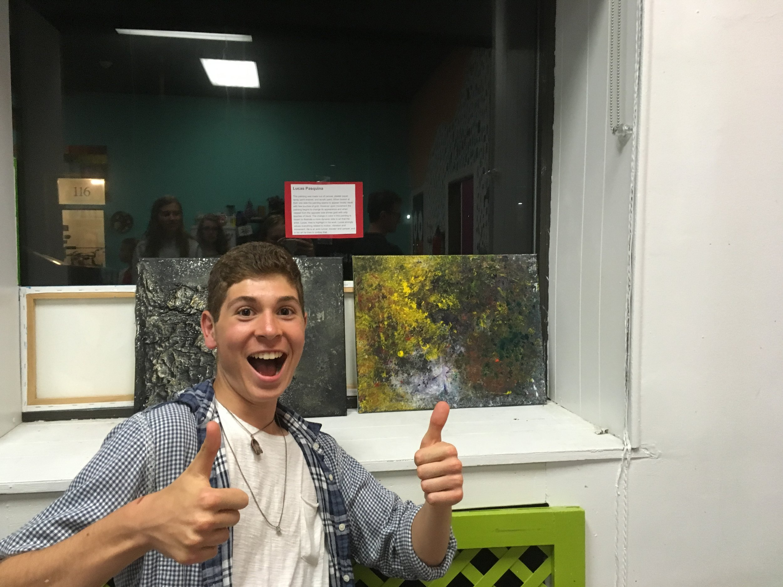 Lucas Pasquina and his artwork. He used acrylic and spray paint to help create his 3D painting