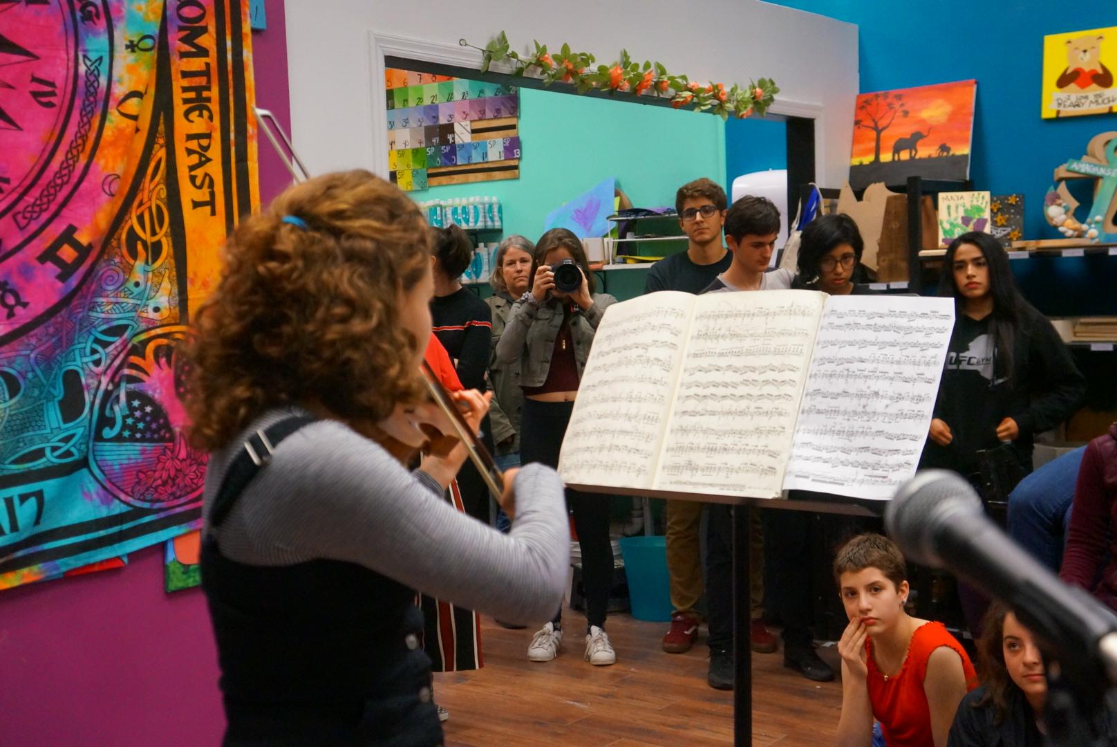 Shai Wexler performing on her violin
