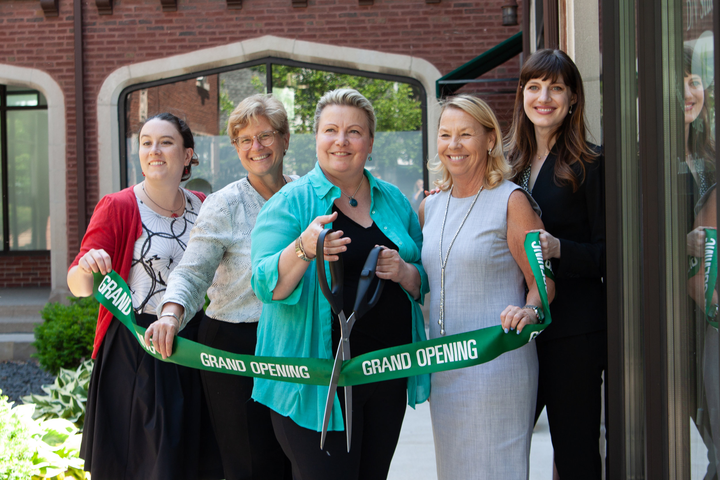 Donna Vitaliano cutting the ribbon for her hair salon next door to Chicago Boudoir Photography