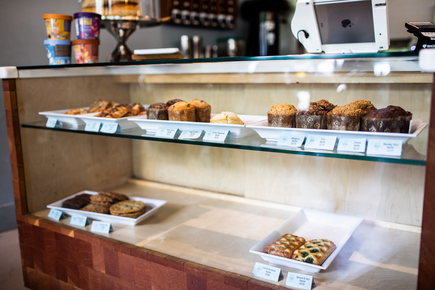 A selection of fresh pastries, cookies, and muffins are available.