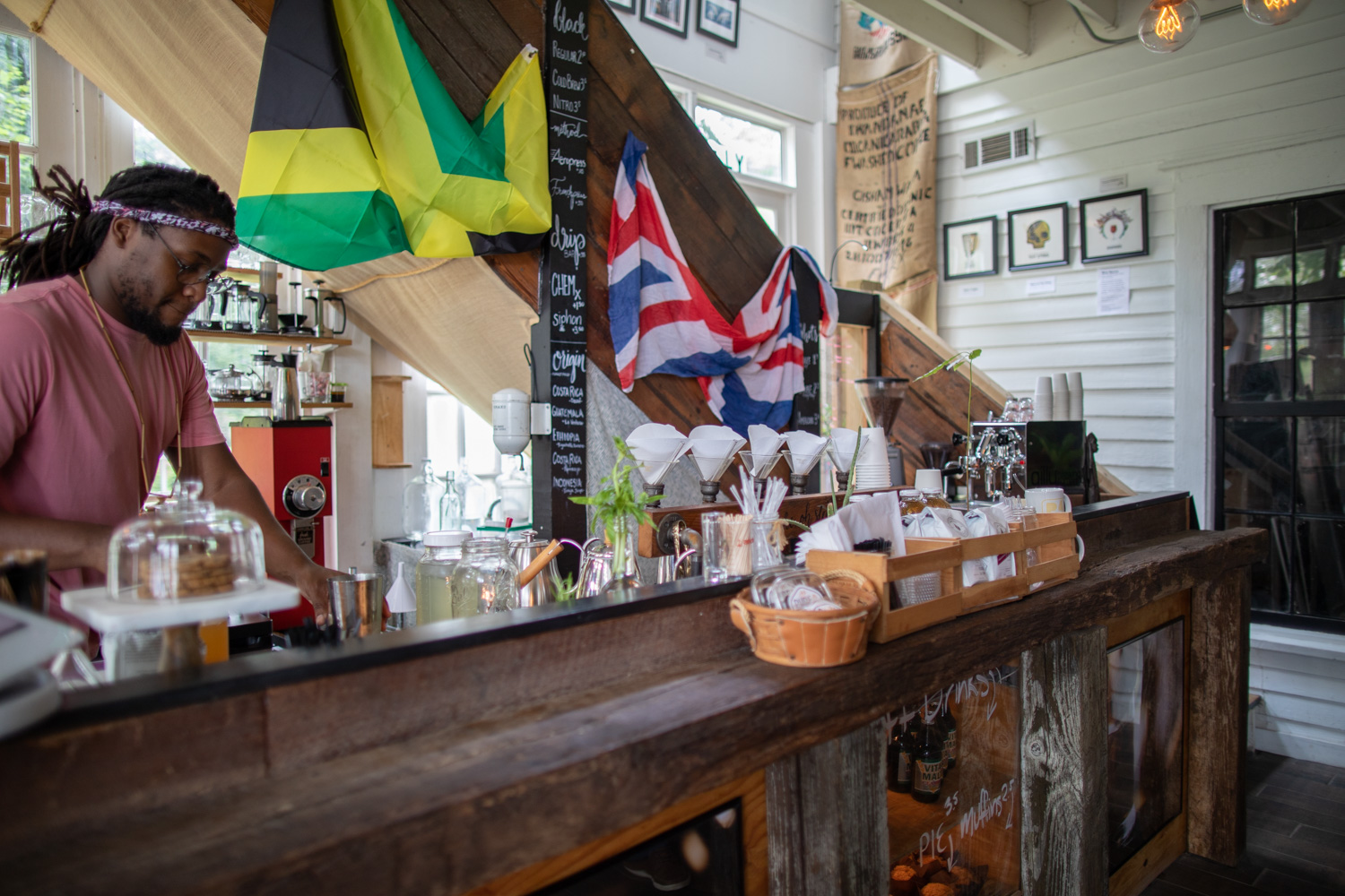 Daniel Brown, owner of Gilly Brew Bar, prepares my order. The Jamaican flag and the Union Jack are a reminder of Daniel's family/relatives who have called Jamaica and the U.K. home.