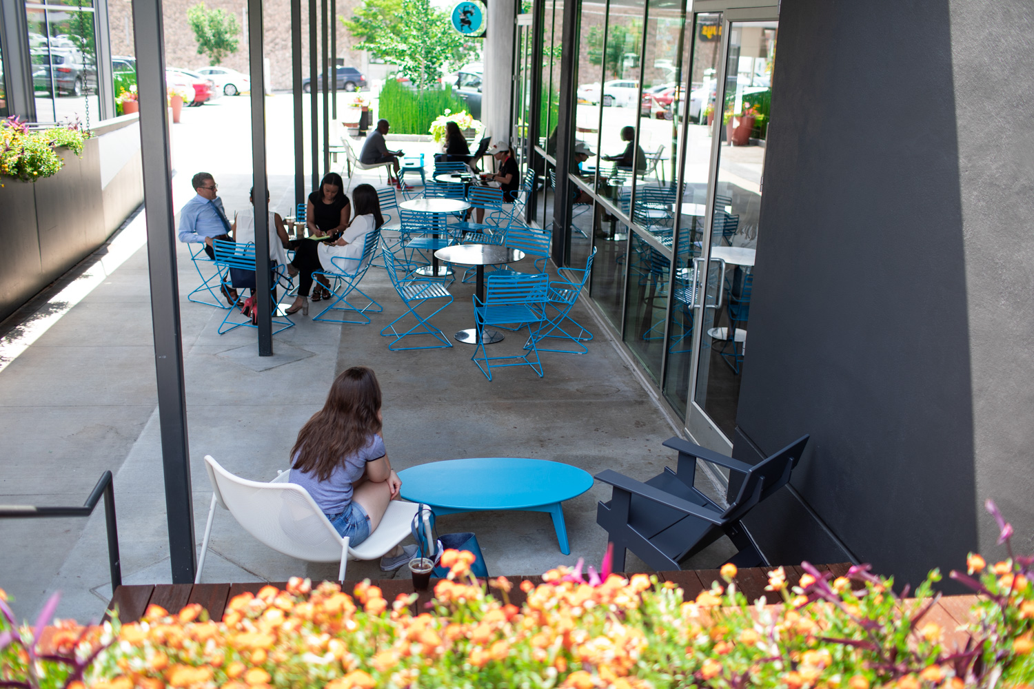 An outdoor patio at Dancing Goats in Buckhead. The outdoor seating is covered and is well-shaded.