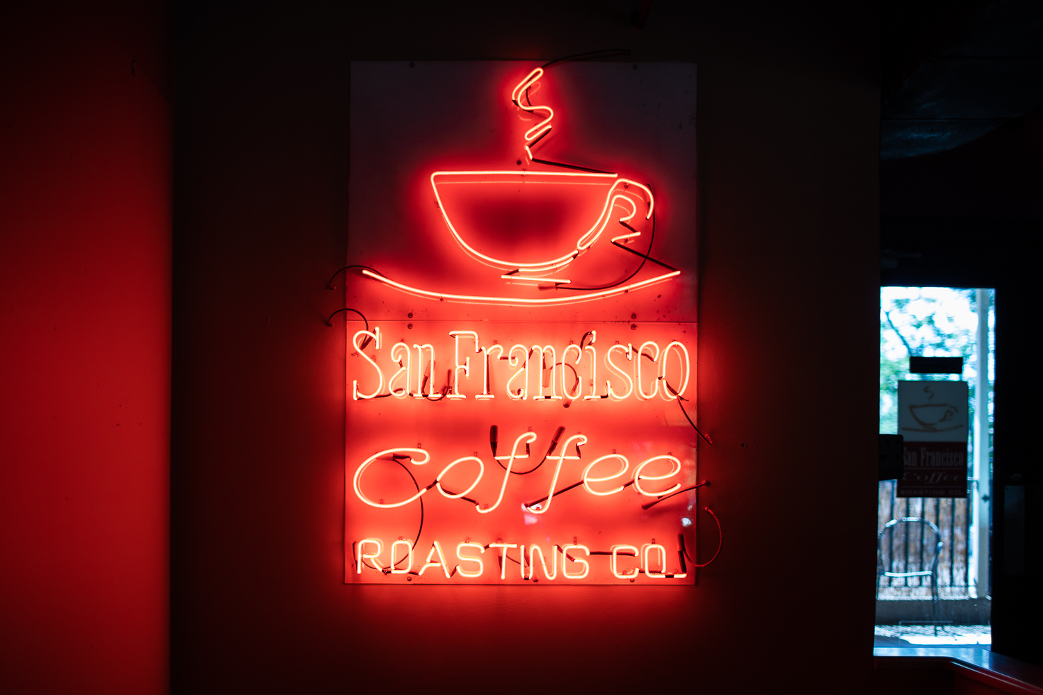 The glowing neon sign is located near the back of the shop. Downstairs is where the roasting of the beans happens on a weekly basis.