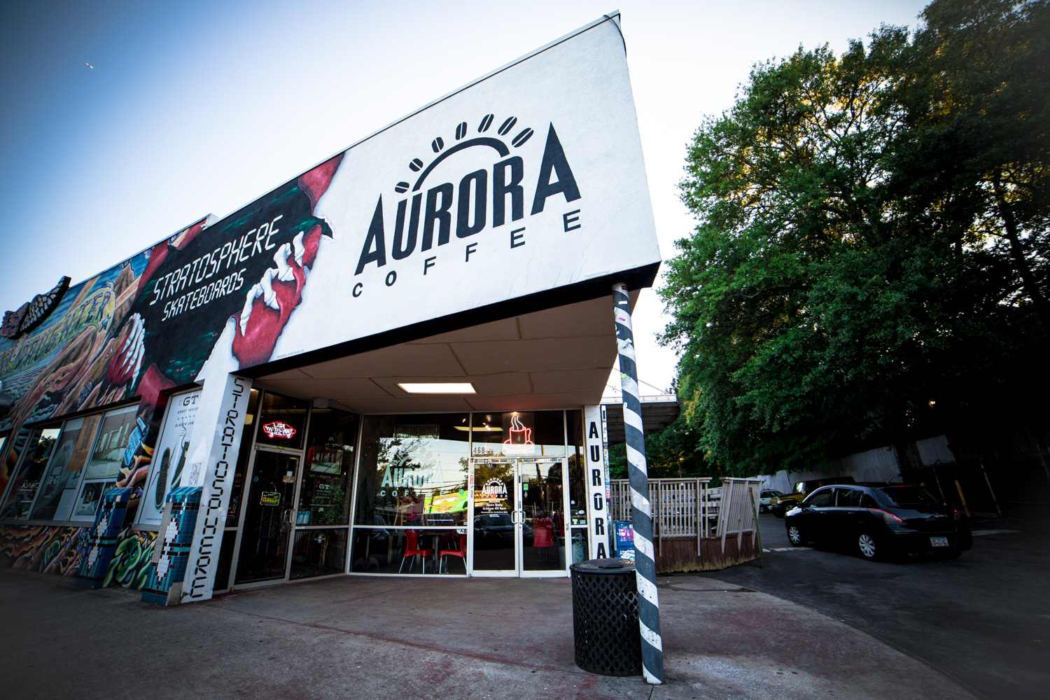 Exterior of Aurora Coffee in the Little Five Points neighborhood of Atlanta, GA. Junkman's Daughter, visible also, is the neighboring store (you can read its brief profile  here ).