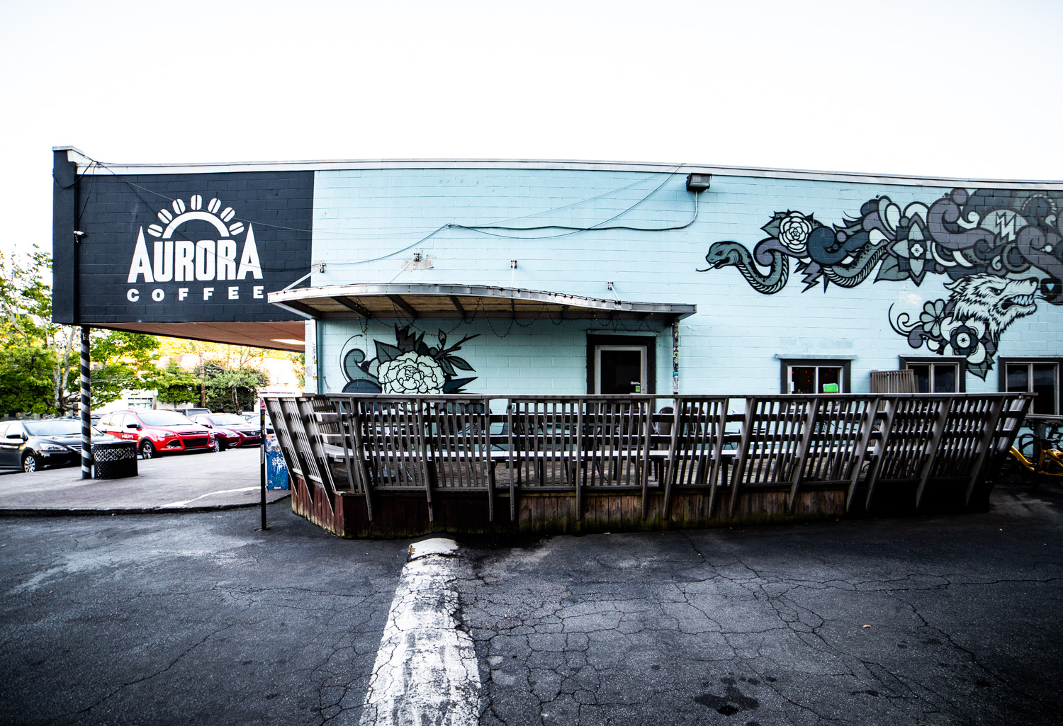 A large wooden patio is one of the features of Aurora Coffee. The artwork is by a local Atlanta artist,  Peter Ferrari .