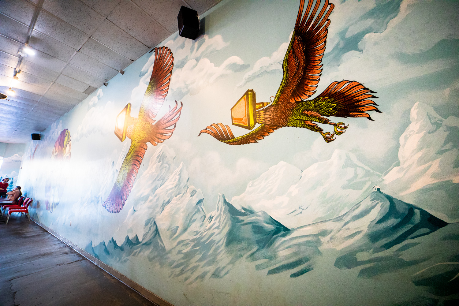 Eagle mutants flying over mountains. (It would be helpful to find out if this mural has a title.)