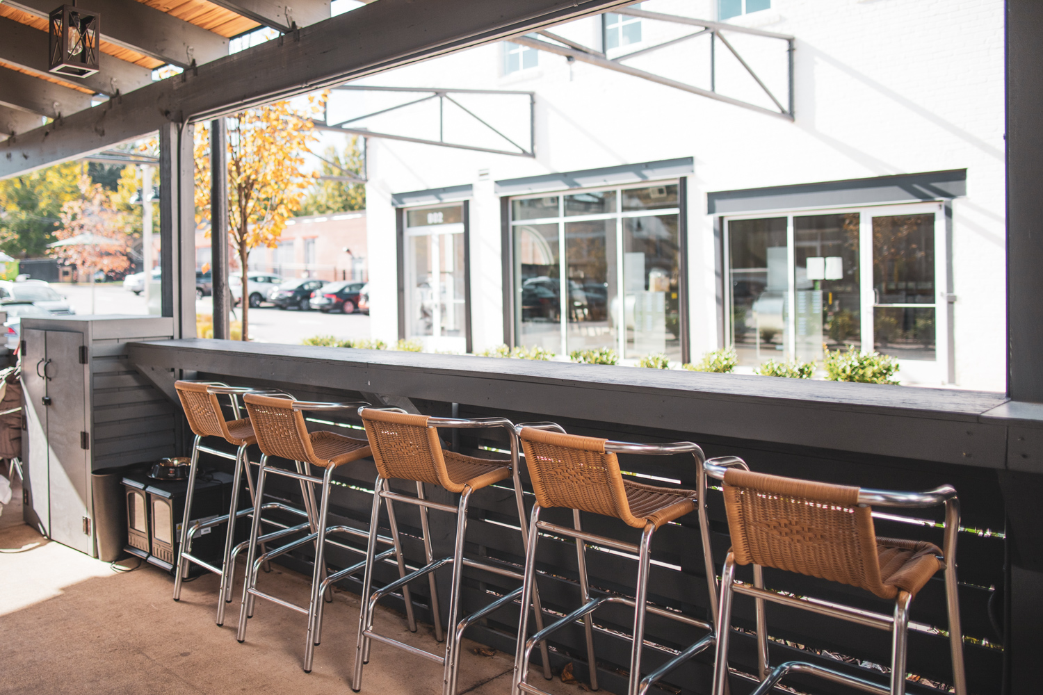 Interior of the covered patio at Full Commission. The high chairs are perfect for sipping coffee or a cocktail.