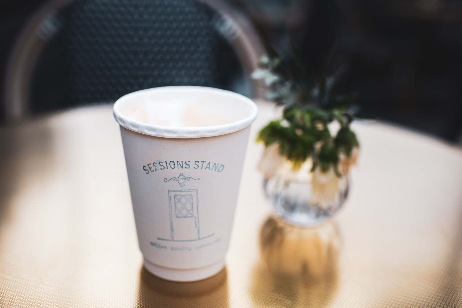Sessions Stand logo on the cappuccino cup.