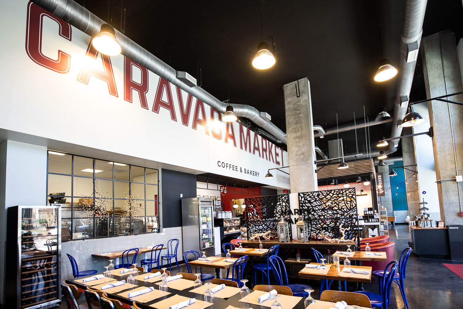 Wide view of the tables at Caravaca Market—the front of World Taste Bar is to the back of this scene.