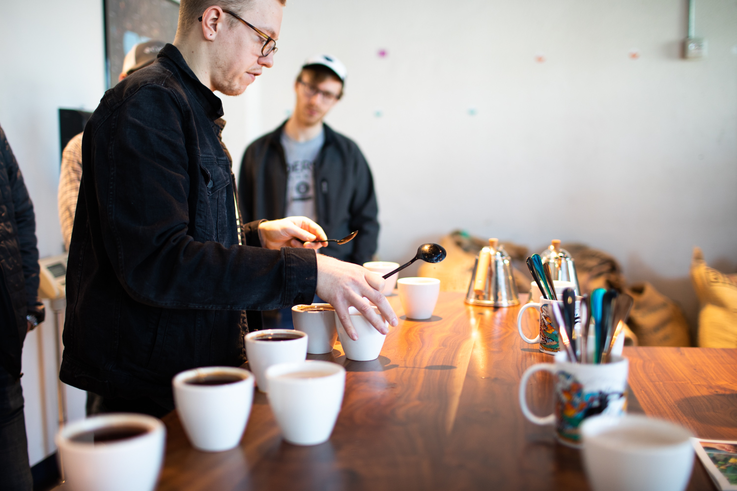 Coffee cupping at East Pole. Whit, holding the two spoons, led the event.