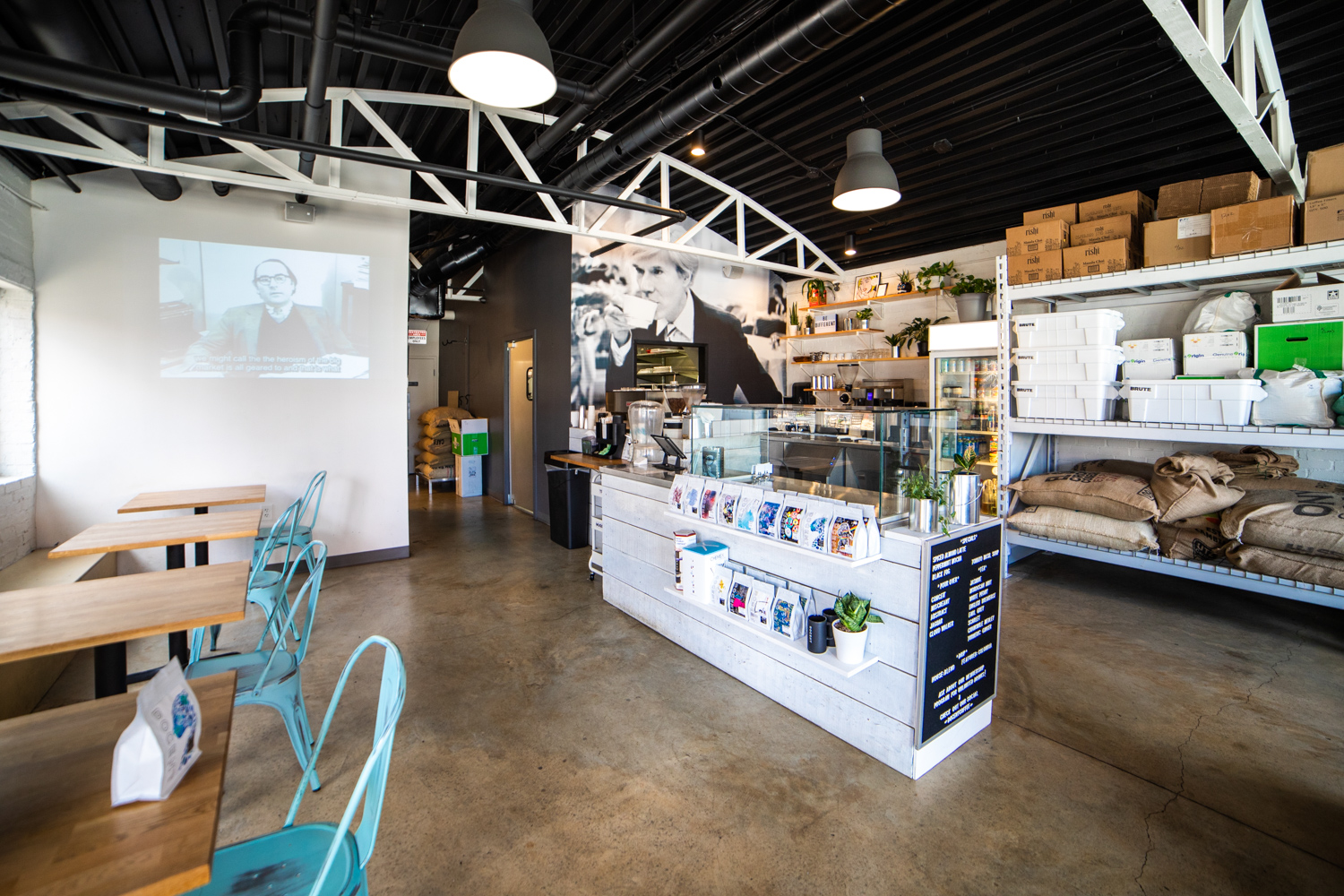 The interior of Docent Coffee. There is a full espresso bar. Docent Coffee also  offers  various sandwiches which are all named for famous artists.