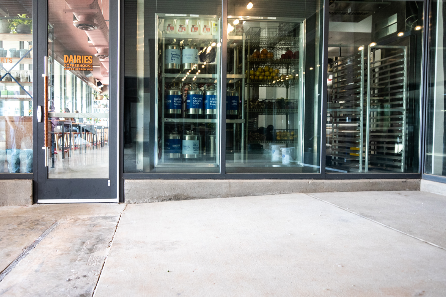 Exterior of Cold Brew Bar with the kitchen and the taps visible.