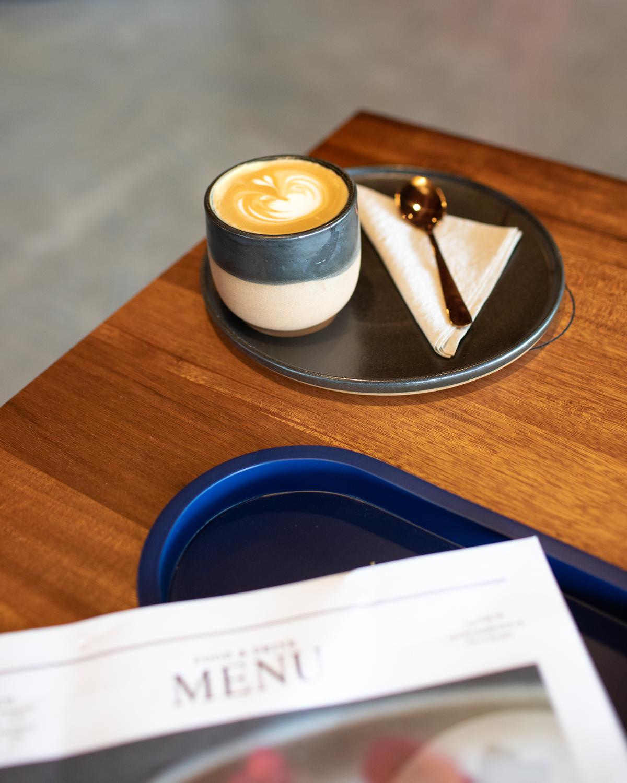 A cappuccino at Cold Brew Bar. The ceramic cups at Cold Brew Bar are from ceramic artist named  Isabel Glatthorn  ( Soul Matter Studio ).