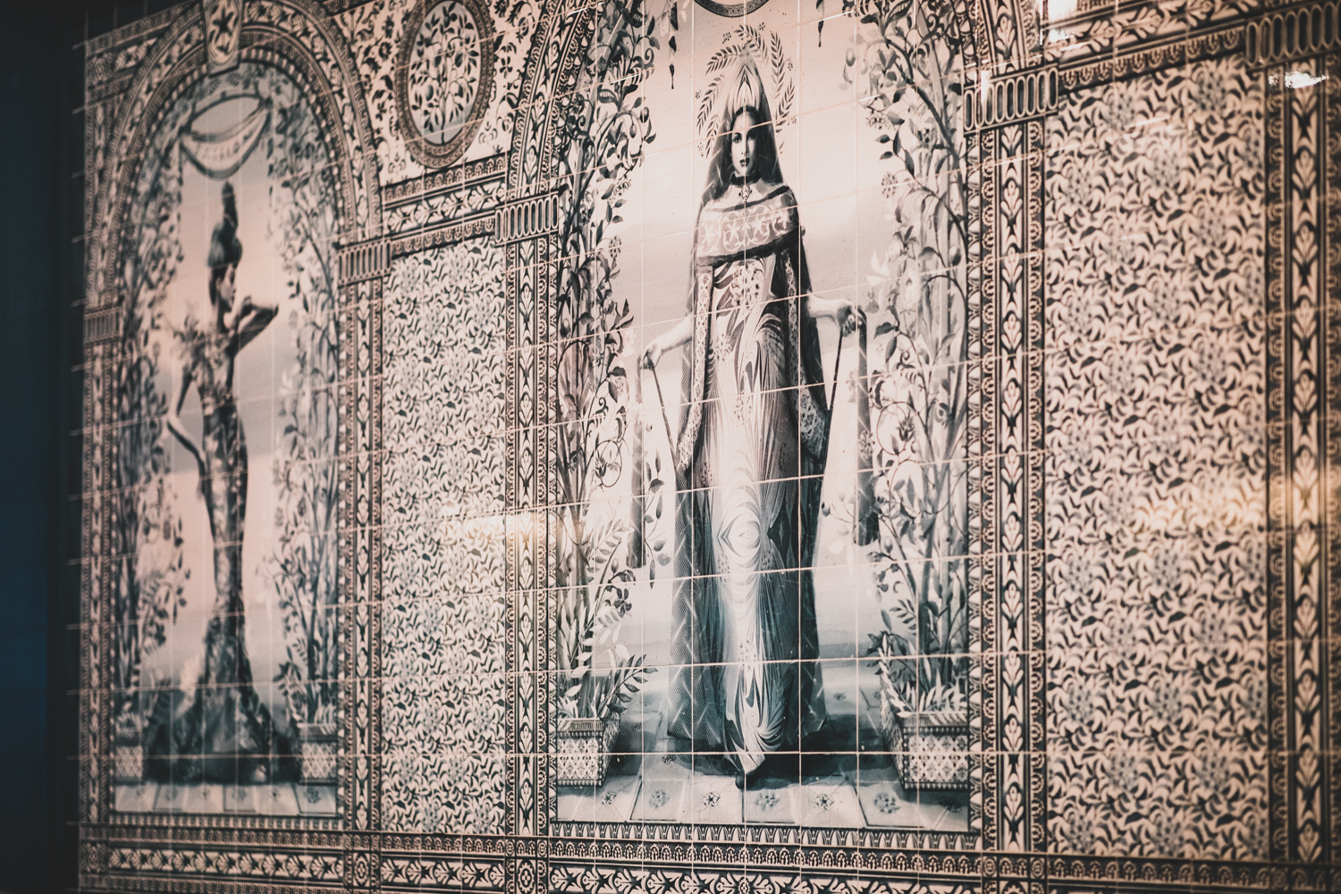 """The tiled wall in """"The Sanctuary"""" at Felix Roasting Co. At far left is Passion and at center is Dedication."""