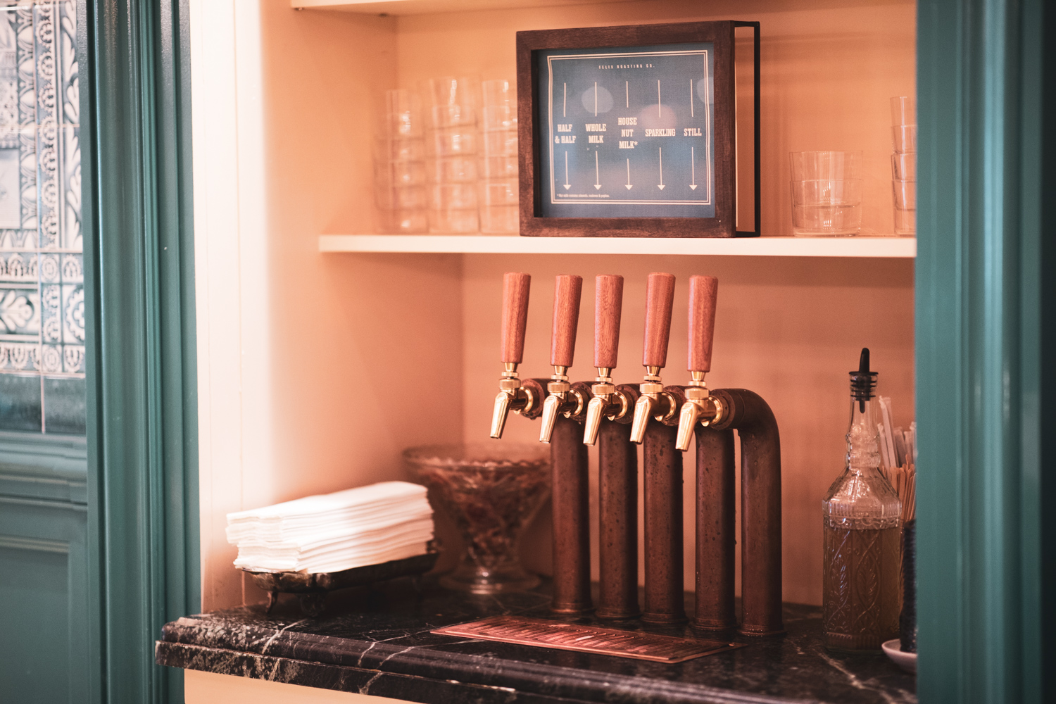 A 5-set tap at Felix Roasting Co., from which customers can dispense half & half, whole milk, house nut milk, sparkling water, or still water.