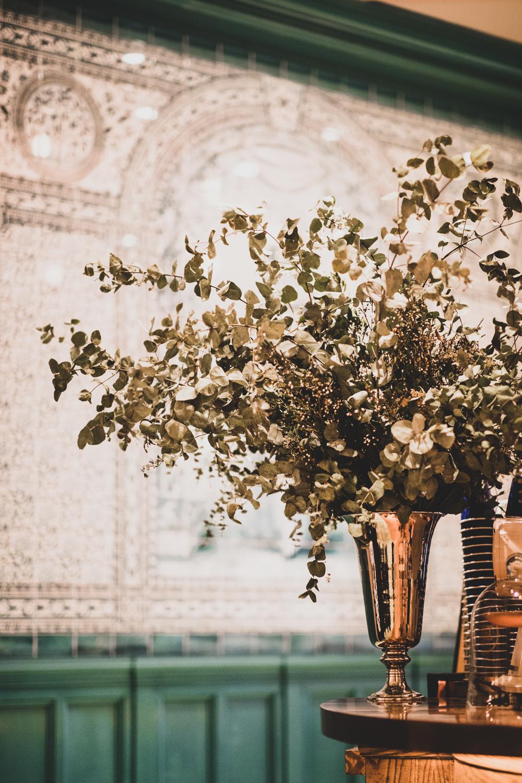 "Beautiful floral arrangements adorn the space inside ""The Sanctuary"" at Felix Roasting Co."