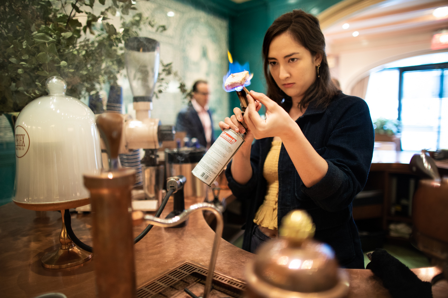 Step 4: Allow the smoke to continue permeating the latte/espresso. Torch the marshmallow to produce a toasted marshmallow. Behind the counter with a fierce look of concentration:  Isabelle , barista at Felix Roasting Co.