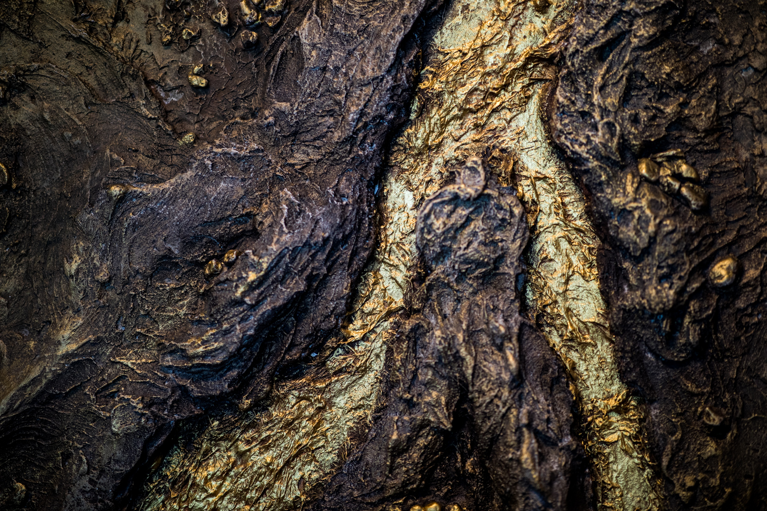 A macro photograph of the golden ridges (terrain) at the back wall of Alchemist Trading Co. It is beautiful!