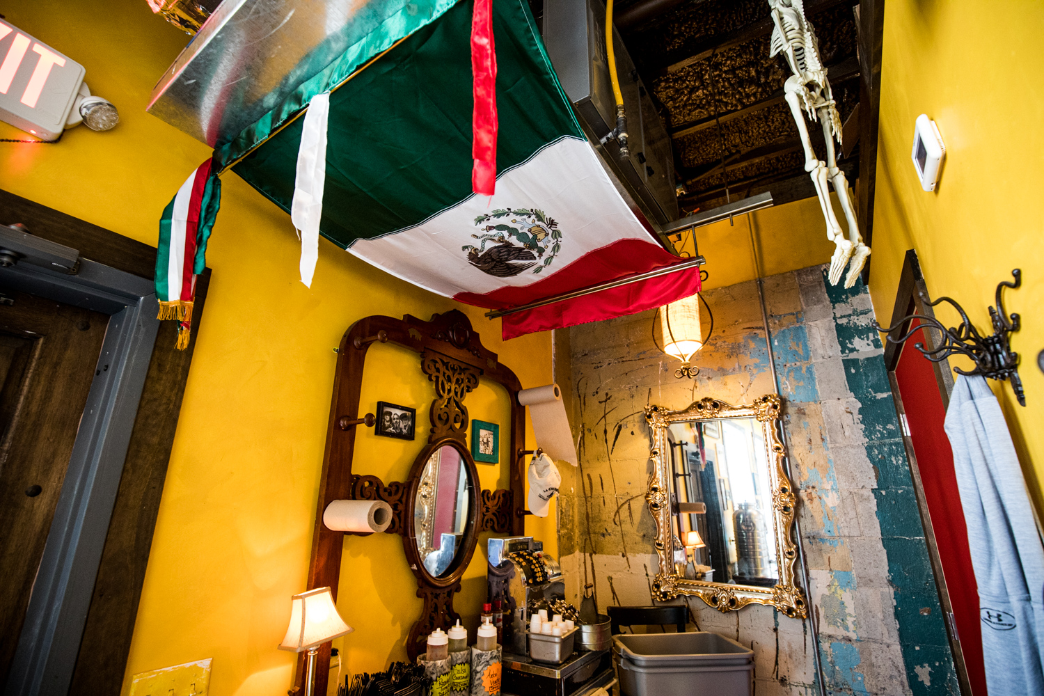 Mexican flag hangs in the back side of El Tesoro.