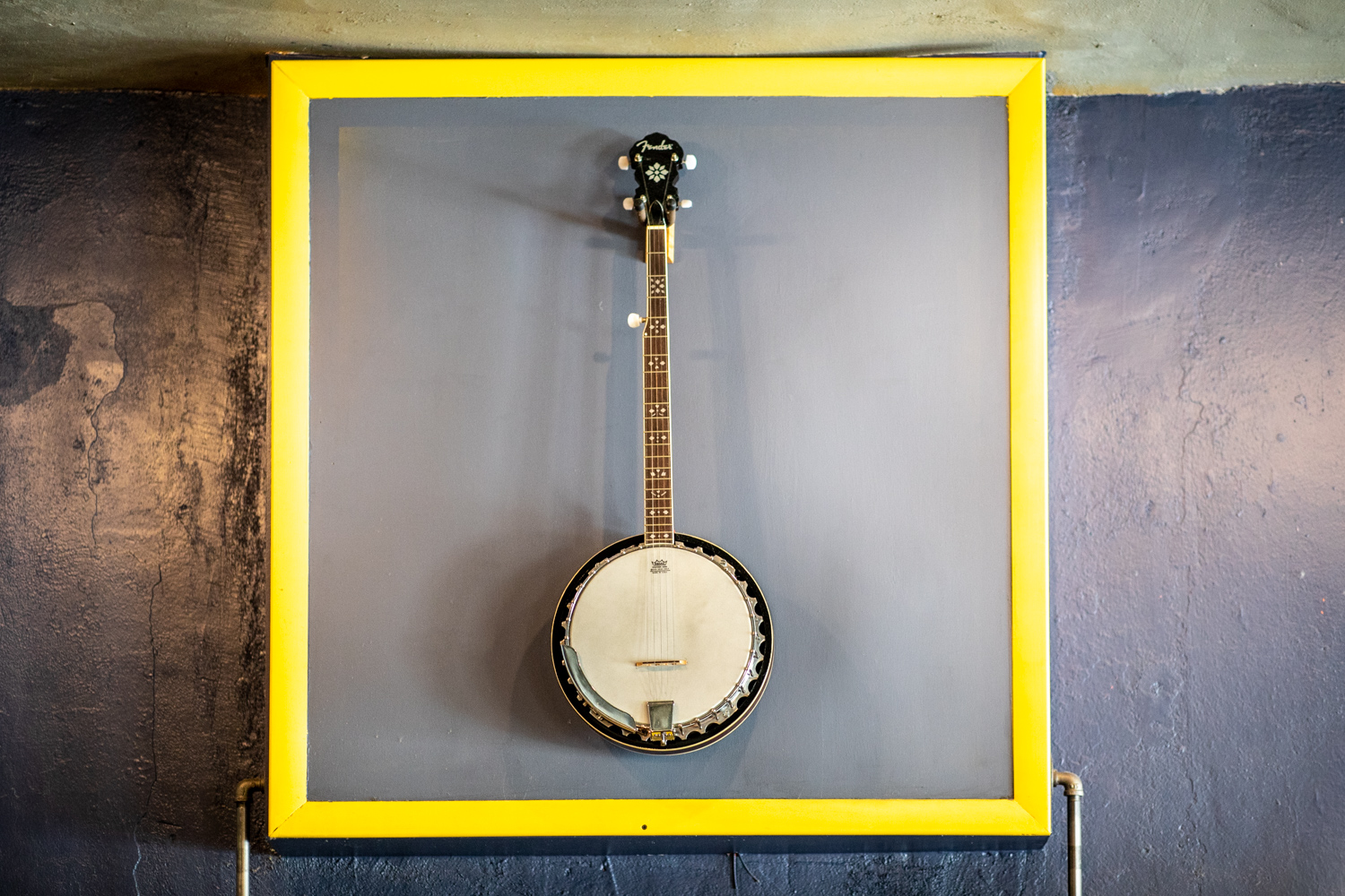 The centerpiece of the coffee shop is this framed banjo—owned by Chasidy's mom and is a testament to the playful nature of the coffee shop.
