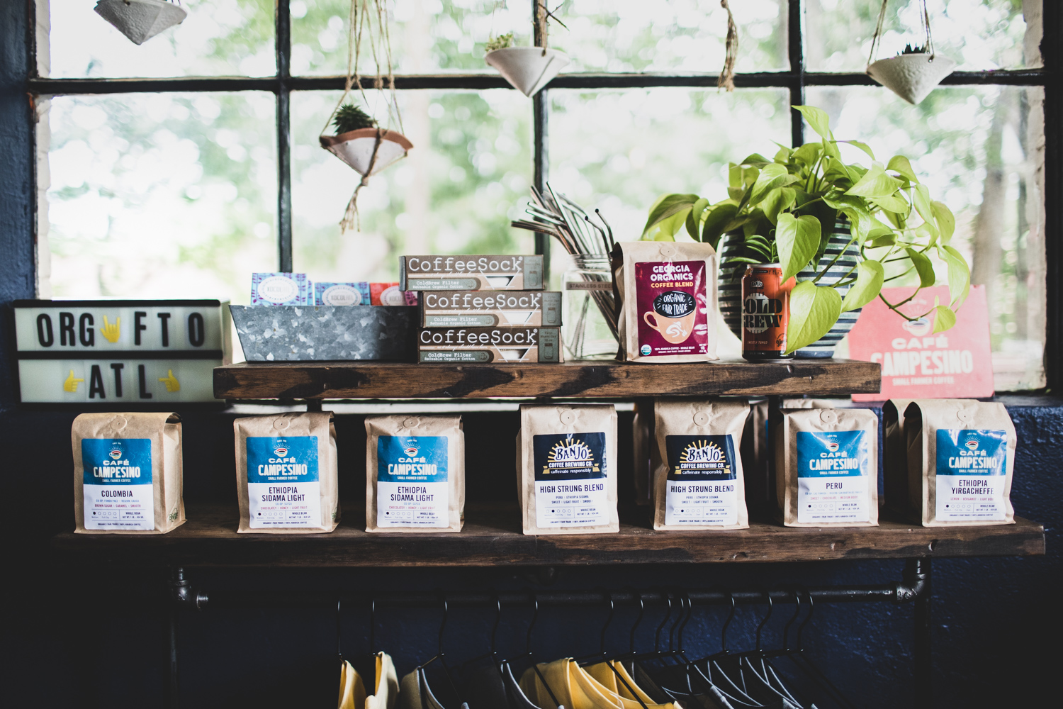 Coffee beans and other merchandise for sale at Banjo Coffee.