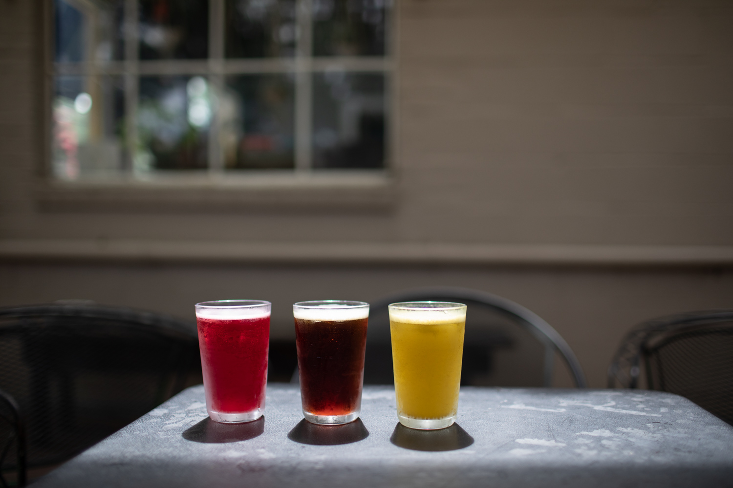 A trio of drinks from Banjo Coffee glistening in the sun.