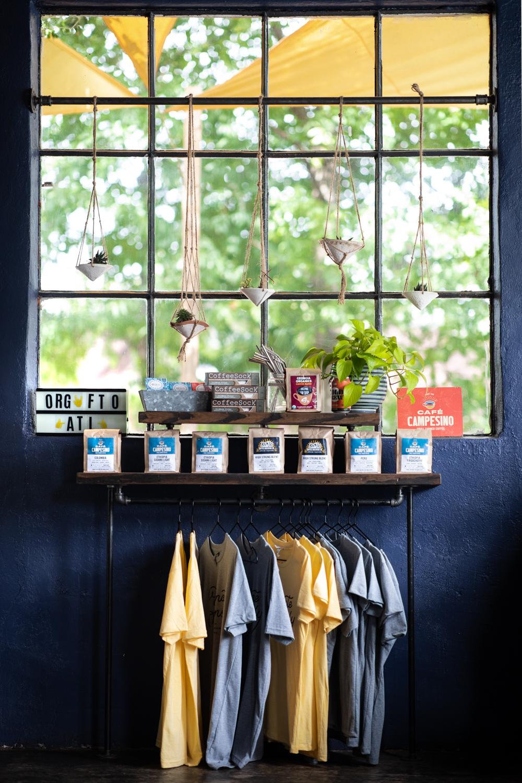 Hanging plants and hanging shirts at Banjo Coffee in Avondale Estates, GA.