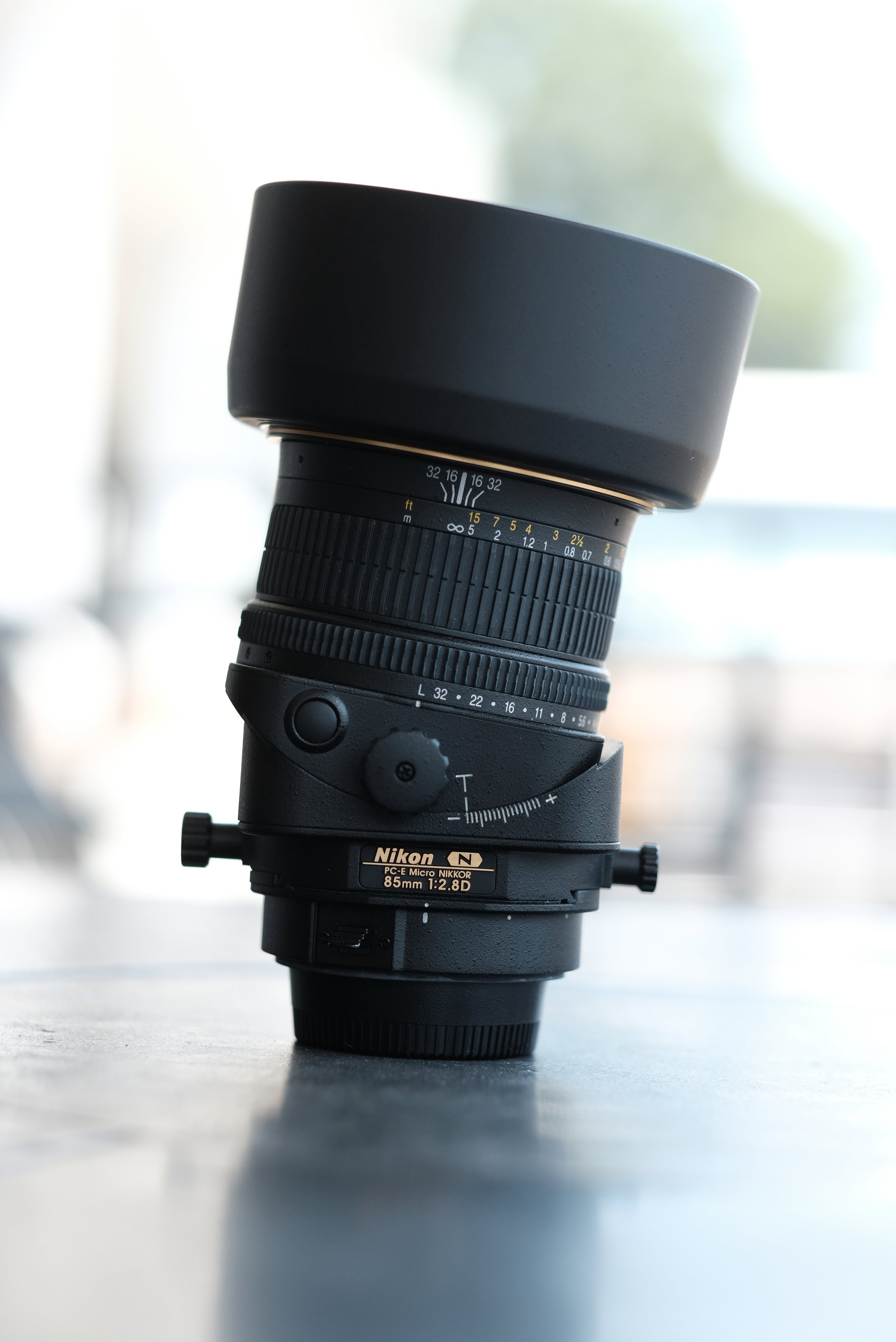 PC-E Micro Nikkor 85mm f/2.8 N - Commercial photographers rejoice! The 85 PC-E is a full frame tilt shift lens. Nikon's Close Range Correction system allows this lens to focus at a wide range of distances by utilizing a floating lens group design. The 1:2 macro perspective will make this lens right at home in any commercial studio or macro photographer's gear bag. The used copy we have is very clean and with our 90 day warranty is a home run for any serious photographer that needs a seriously versatile lens.
