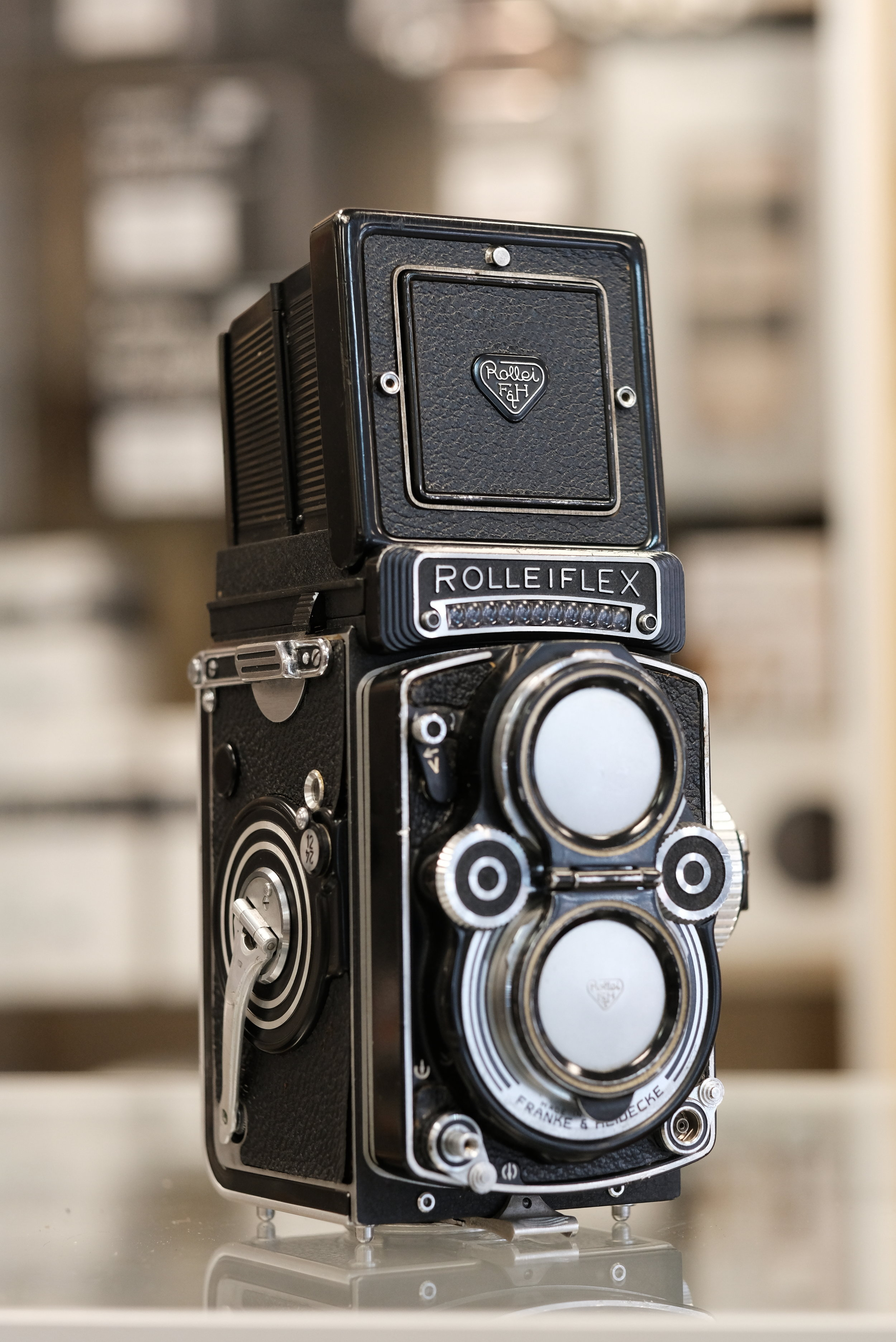 Rolleiflex 3.5F & Accessories - This classic twin lens, medium format camera is in great condition with only a few cosmetic flaws. The meter is non-reliable, but that is expected with any decades old selenium meter and can be overcome with one of the free light meter apps for your smart phone. This camera comes complete with a brown leather case, set of 3 Rolleinar close up lenses and the original owner's manual, all of which are in remarkably good shape.