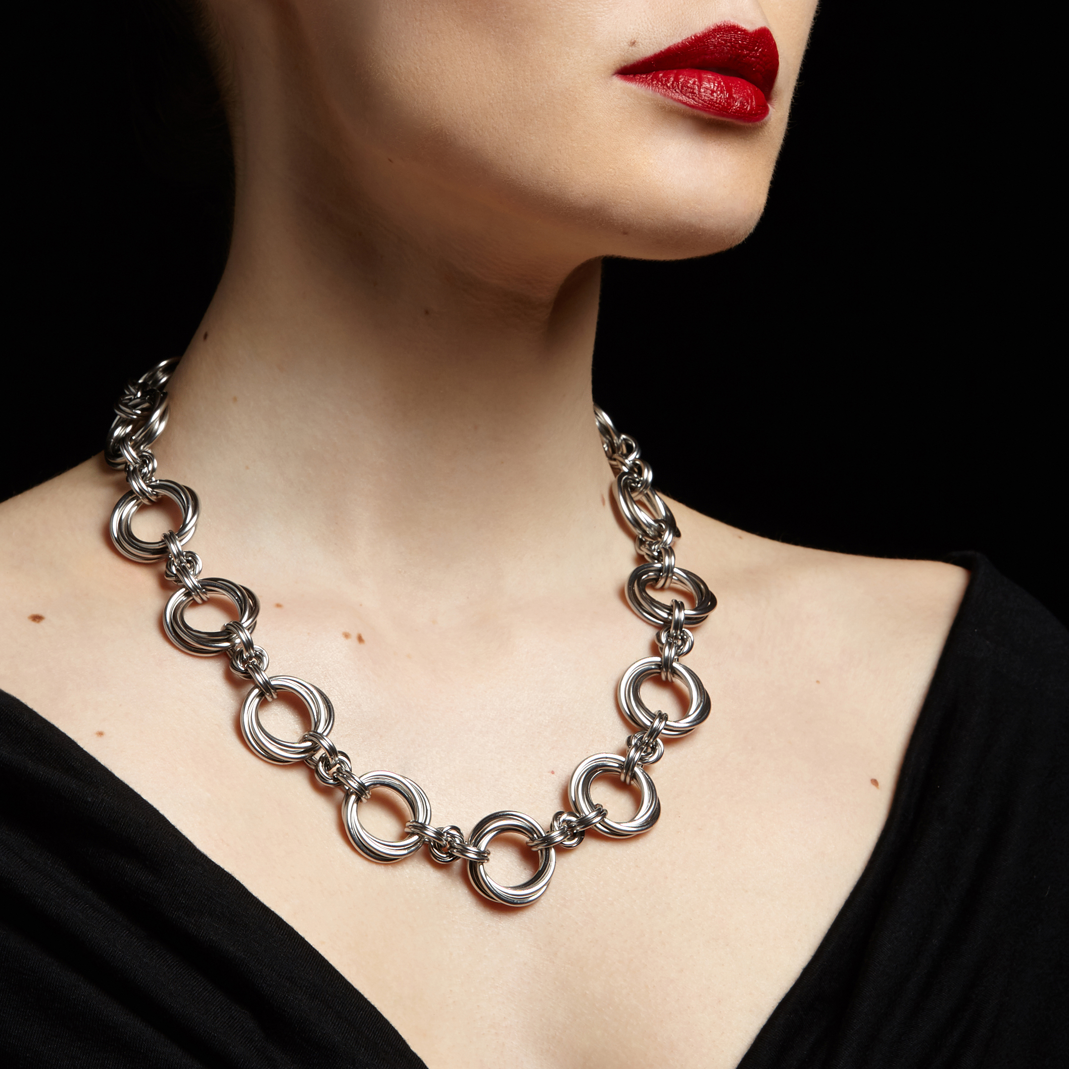 Rapt in Maille   My stainless steel jewelry combines traditional patterns of chainmaille with contemporary decorative elements and a modern, urban design sensibility. A significant focus of my work lies in the provocative integration of masculine vs. feminine. I build the chainmaille by opening and closing individual links to weave them together in a specific pattern. If a piece has any length of chain in the design, each chain is painstakingly measured and cut so that the design lays properly on the wearer, with placement, weight, and gravity playing a major role. – Melissa Banks  Website:  http://www.raptinmaille.com