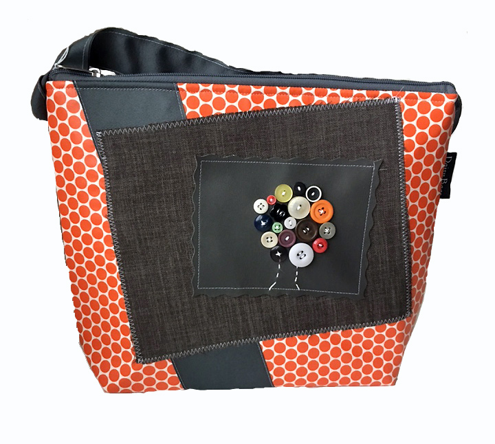 "Daisy Bags   I've always loved sewing-in high school I made my own clothes. When my girlfriends started having babies, they all got baby quilts. Sewing has always been a part of my life. In 2004, I was on the search for an affordable bag featuring a photo of my first ""baby""-a black Labrador retriever named Daisey. I found one -- for $200. Rather than fork over that much cash, I decided to just make one myself and Daisy Bags was born. Over the past decade, Daisy Bags has evolved into a multiline handbag and accessory company for the whole family. – Jill Scales  Website:  http://www.daisybags.com/"