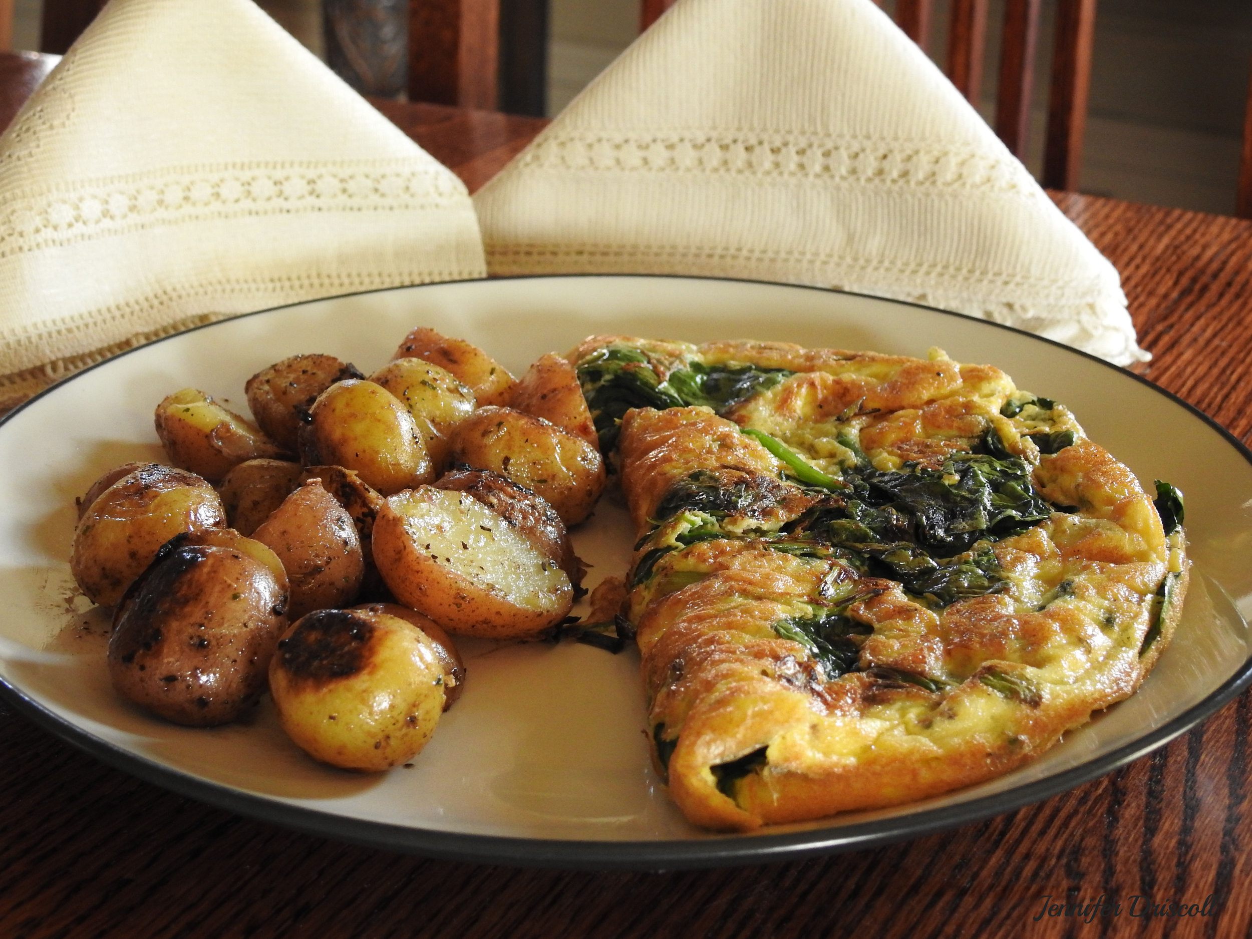 SPINACH AND ONION OMELET - SIDES: CHOOSE BABY POTATOES OR BACON