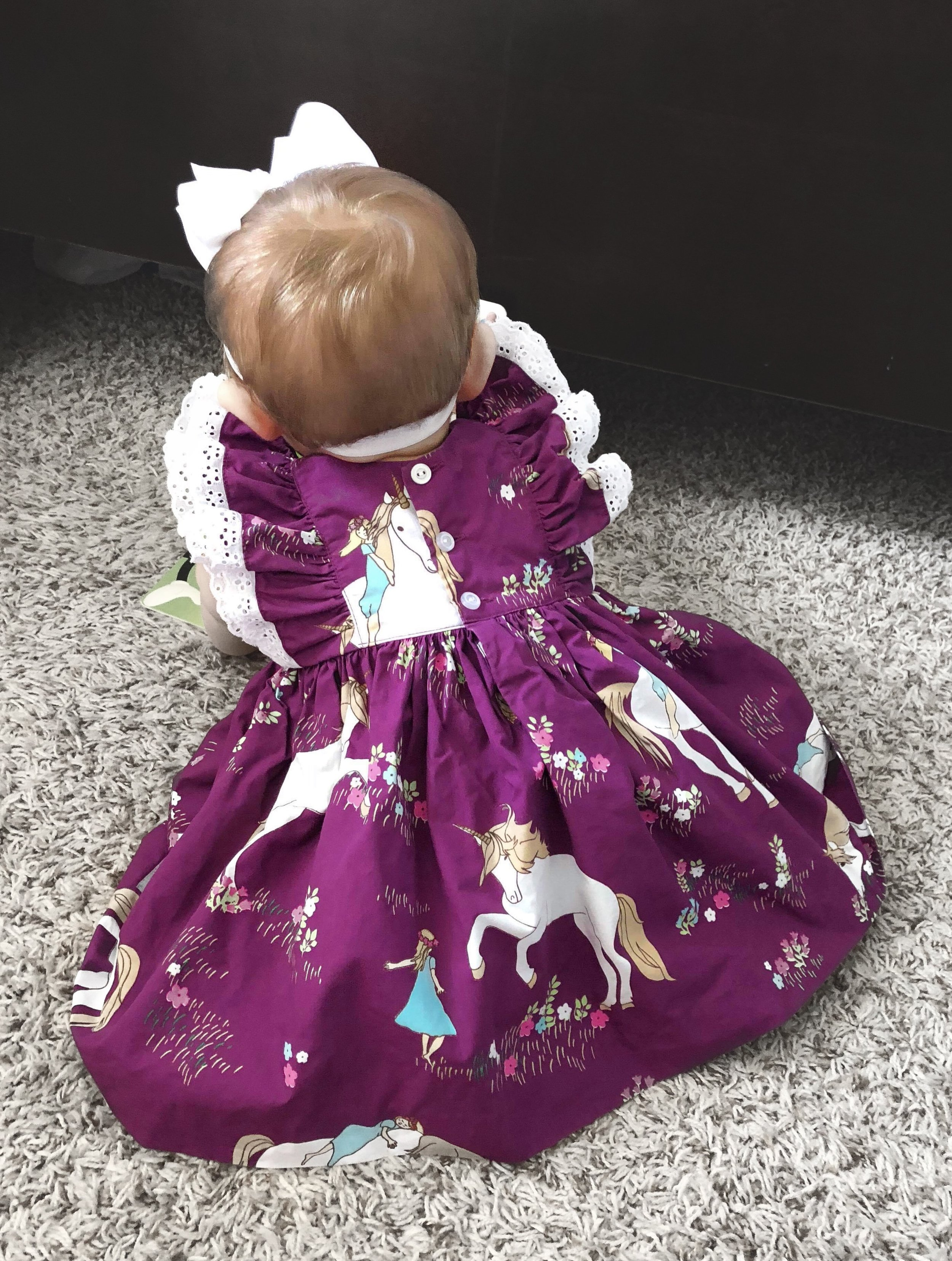 Fabric I designed for Eleanor Rose, beautifully modeled by Miss Emily Grace. :)