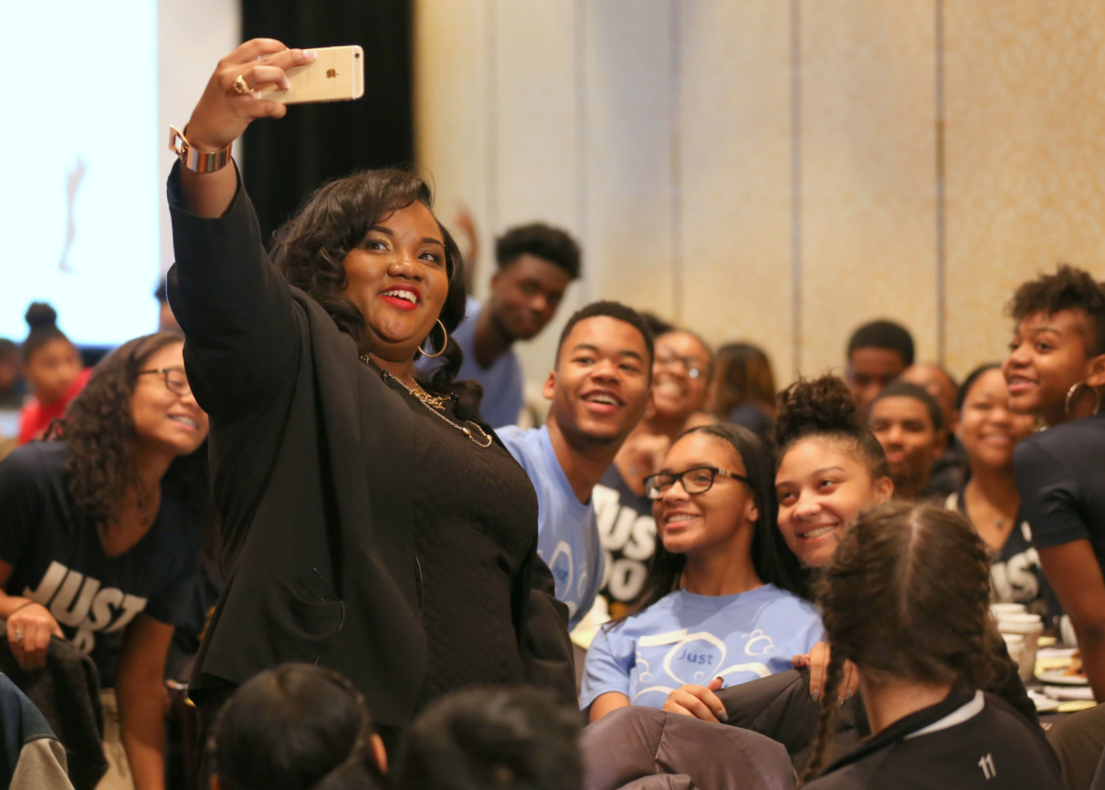 Mimi taking a selfie break during her keynote with students during the Michigan Associations of Student Councils and Honor Societies conference.