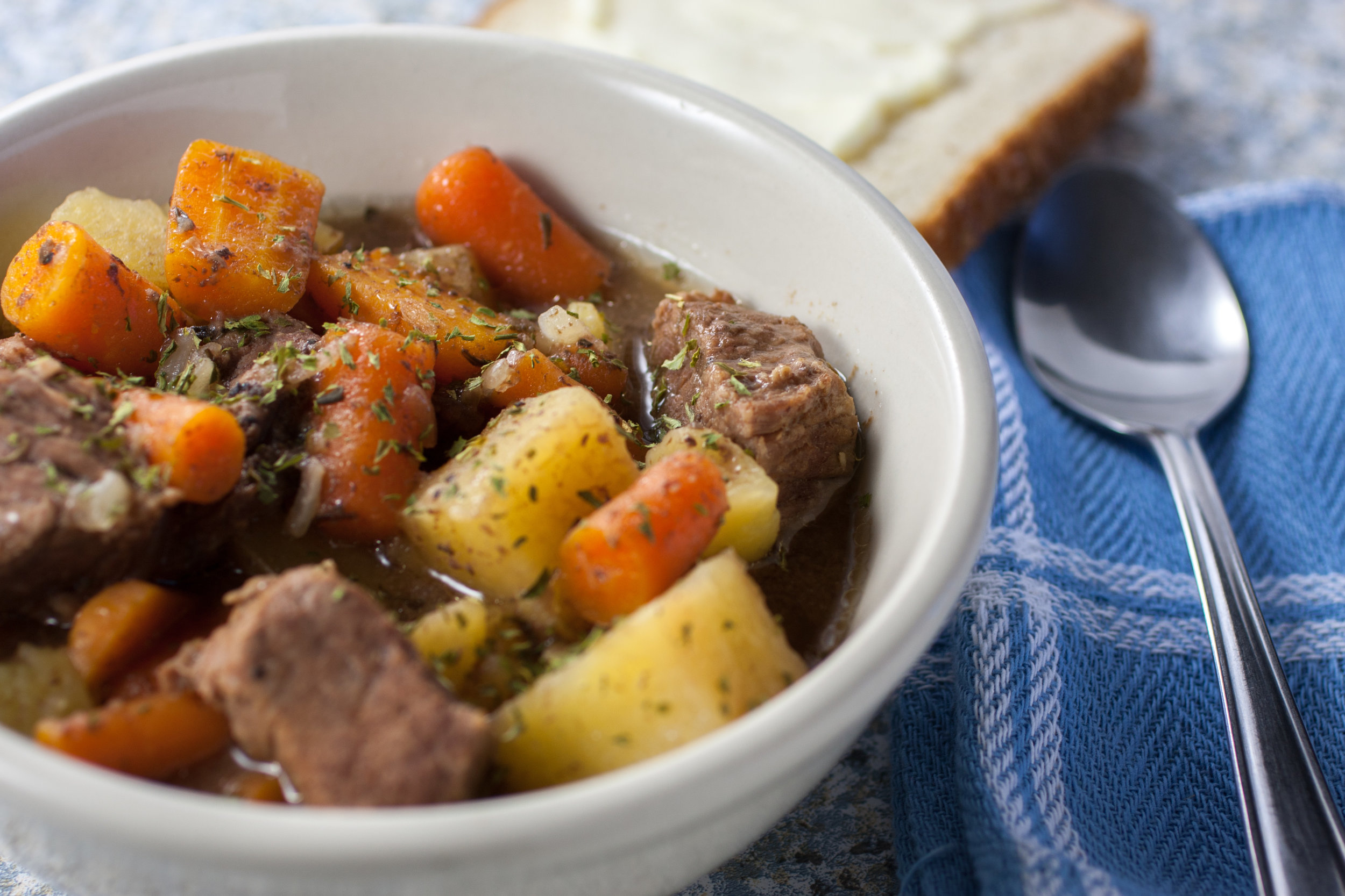 Dutch Oven Stew - Ingredients: Hamburger, Potatoes, Mixed Vegetables, Italian Stewed Tomatoes, and Lawry's seasoning.