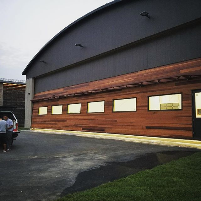 Not a bad place for a plane to call home. 🛫We painted the exterior and stained the door for this beautiful airplane hangar.
