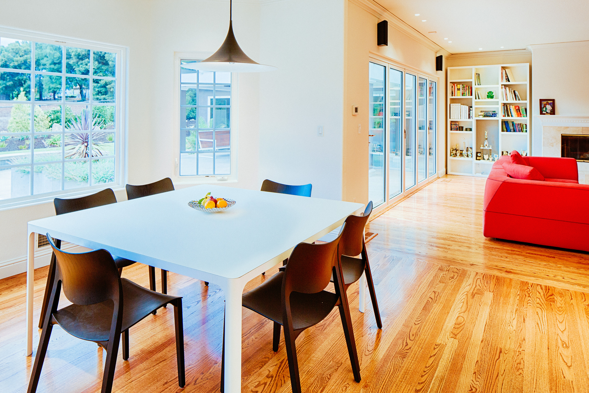 White dining table with dark chairs