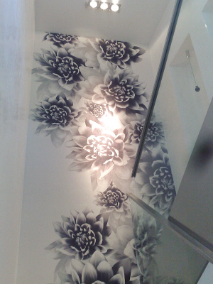 staircase wall with a white and black mural wallpaper with flowers