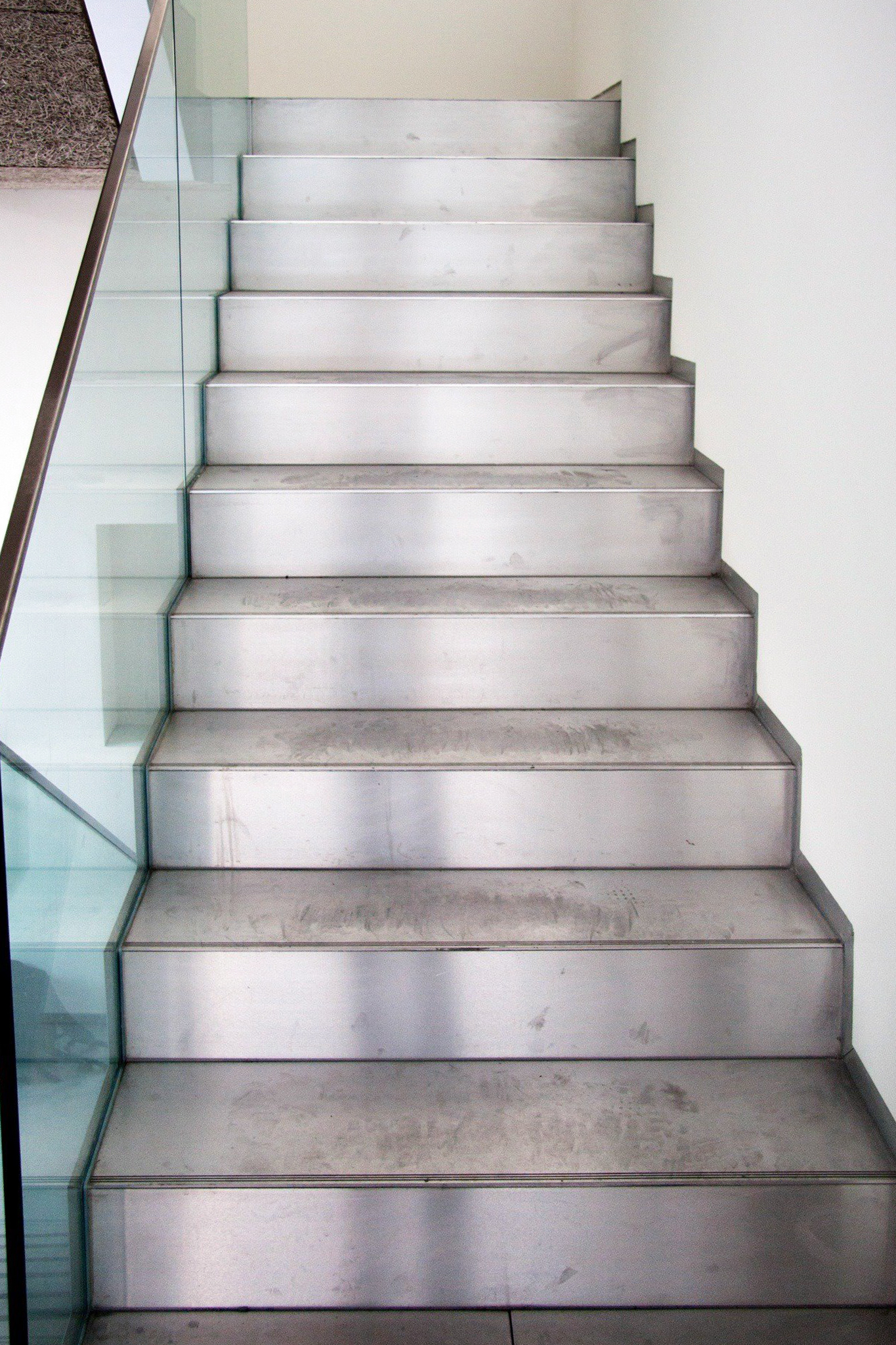 Modern steel staircase with glass railing