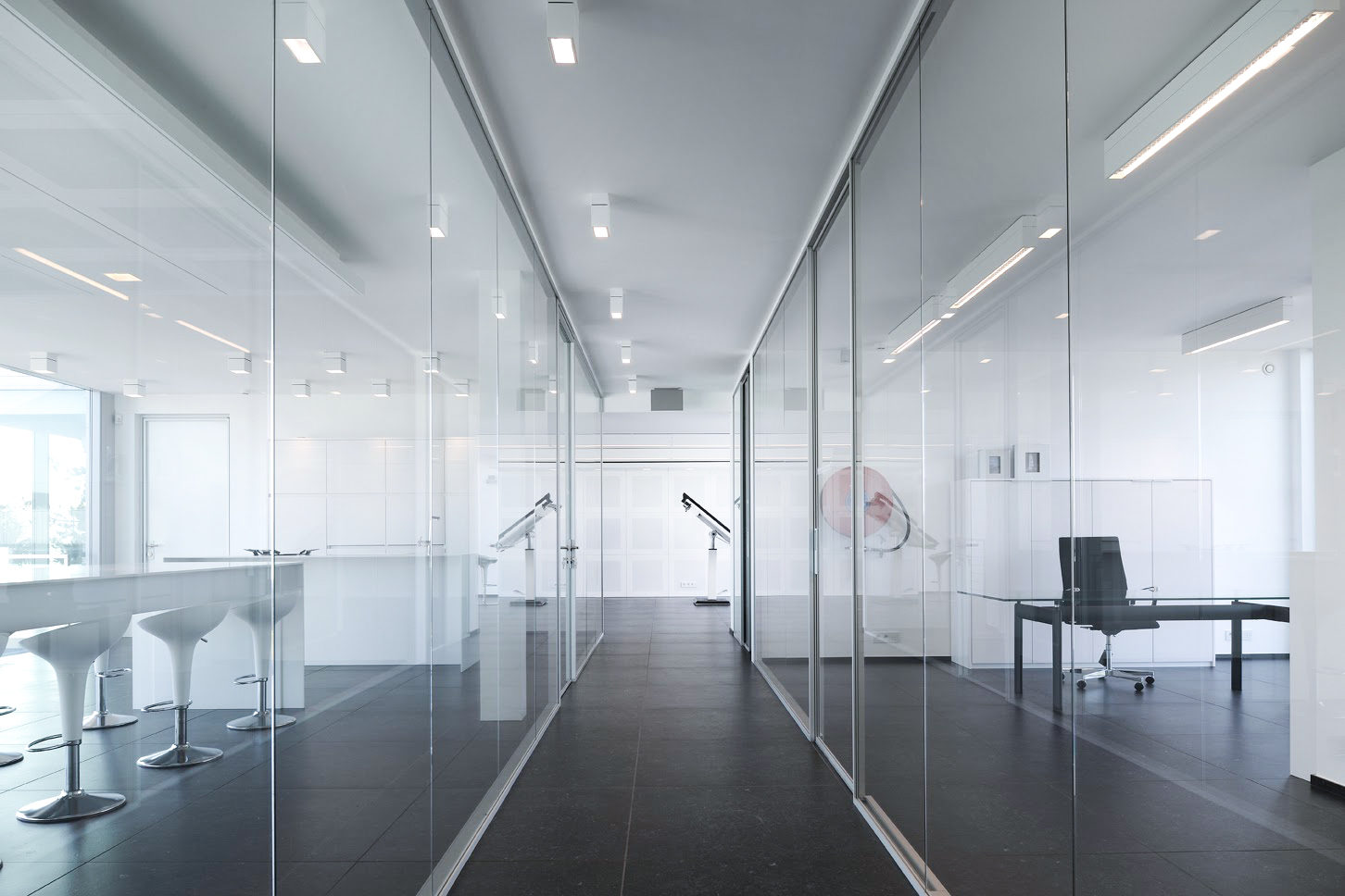 modern office hallway with big glass windows
