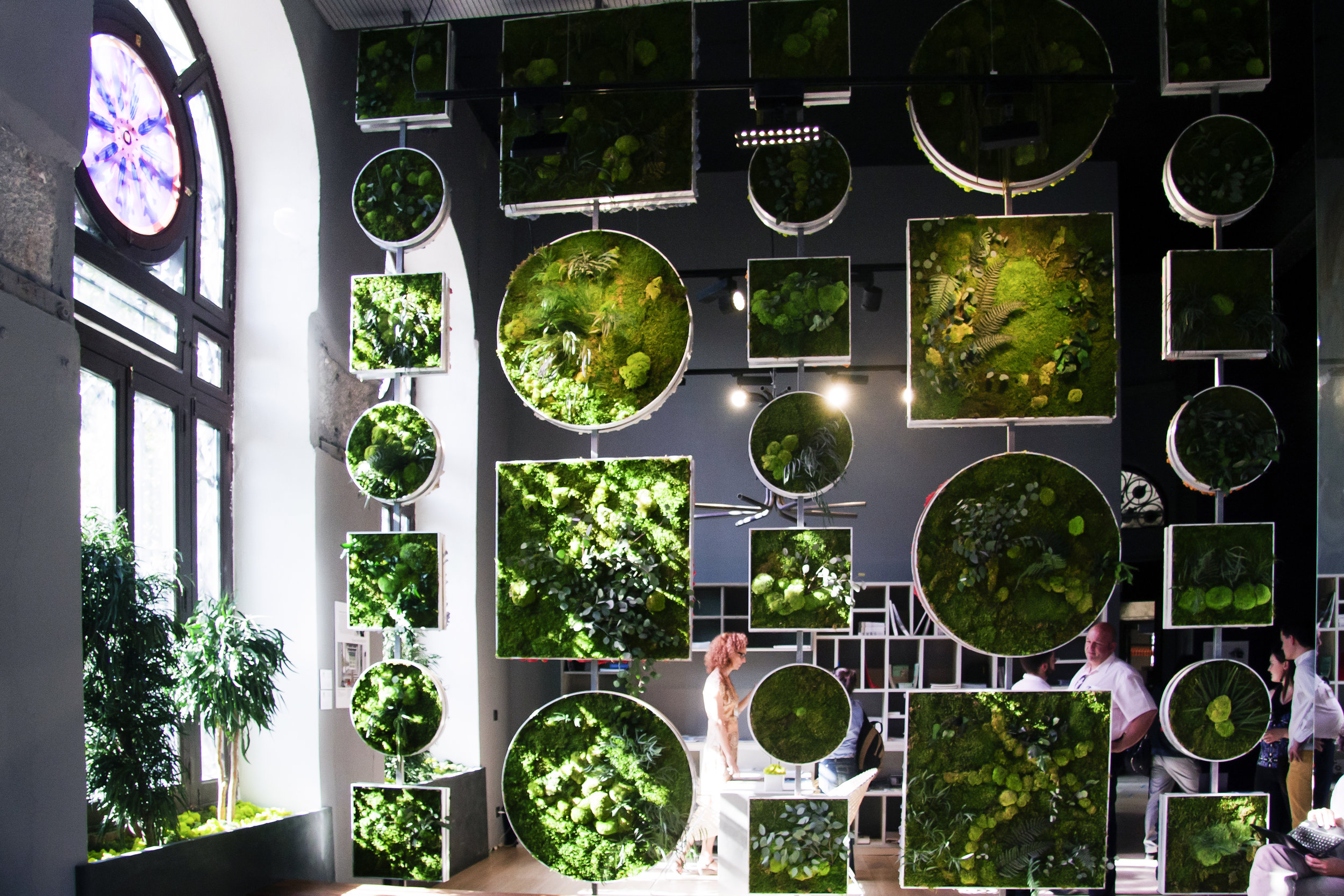 lobby area with vertical garden plants in round and square shape