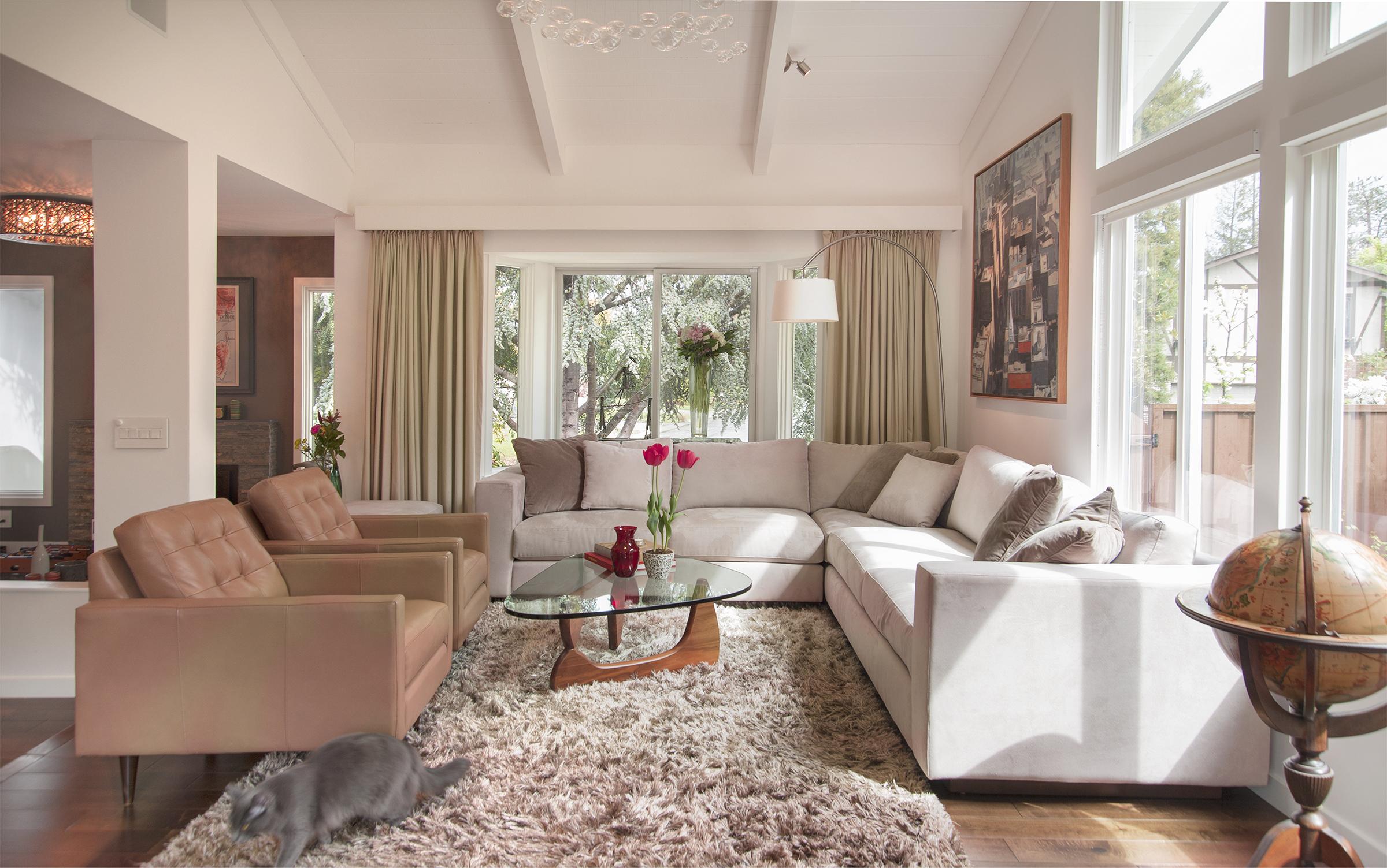 Corner sofa with two armchairs, Noguchi coffee table and big window
