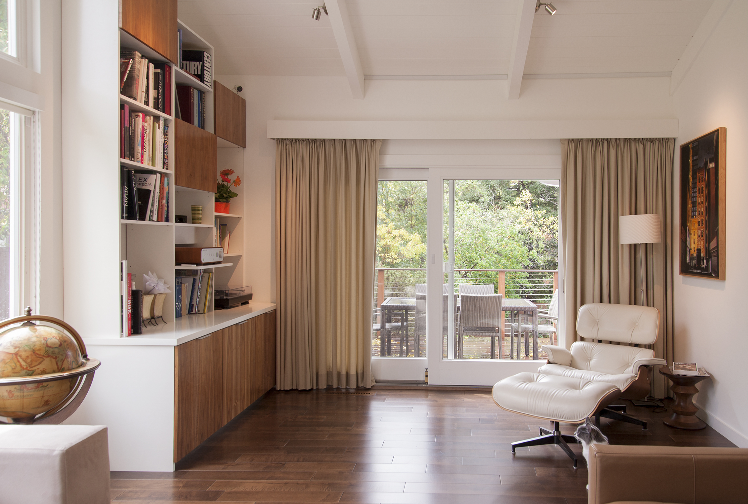 Bookcase with a white leather Eames armchair