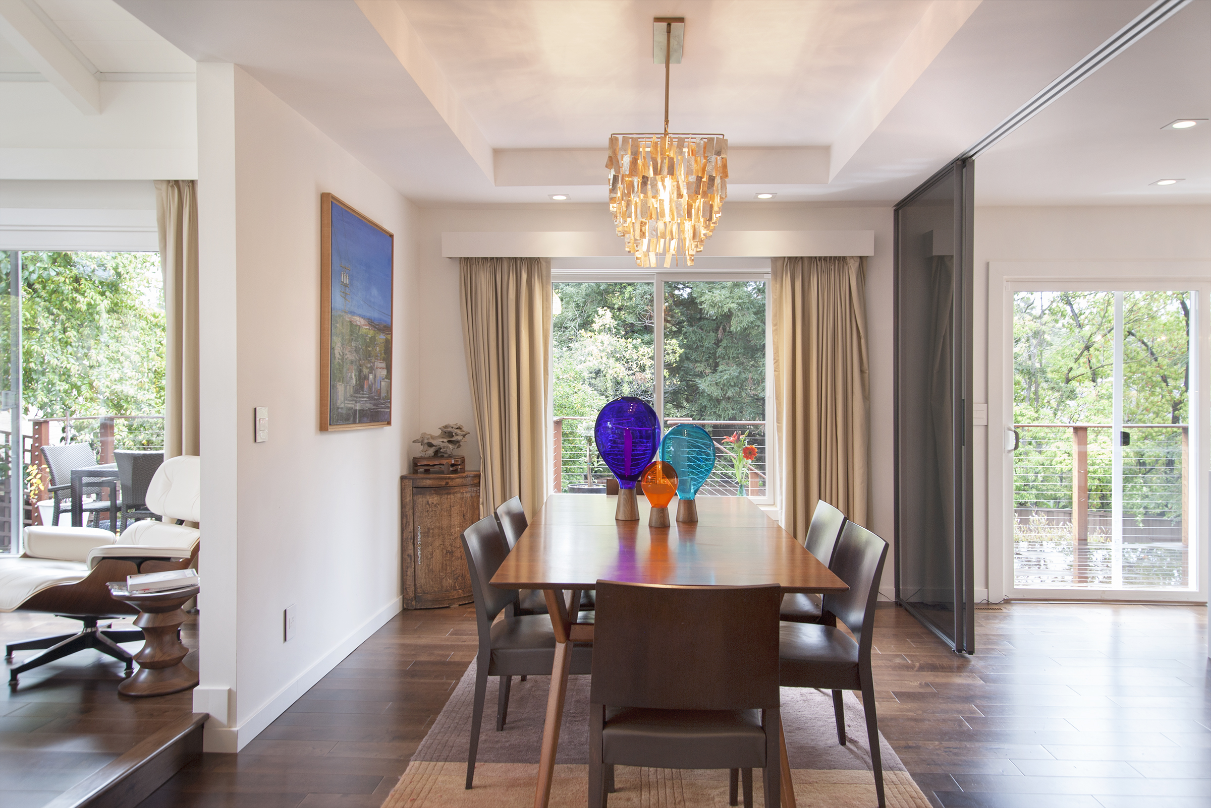 Dining table and chairs with colorful glass vases