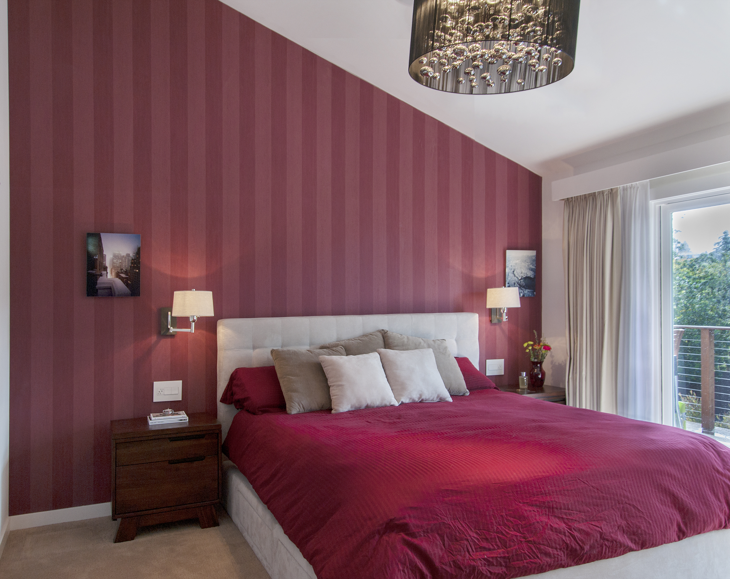 Bedroom headboard covered with red wallpaper