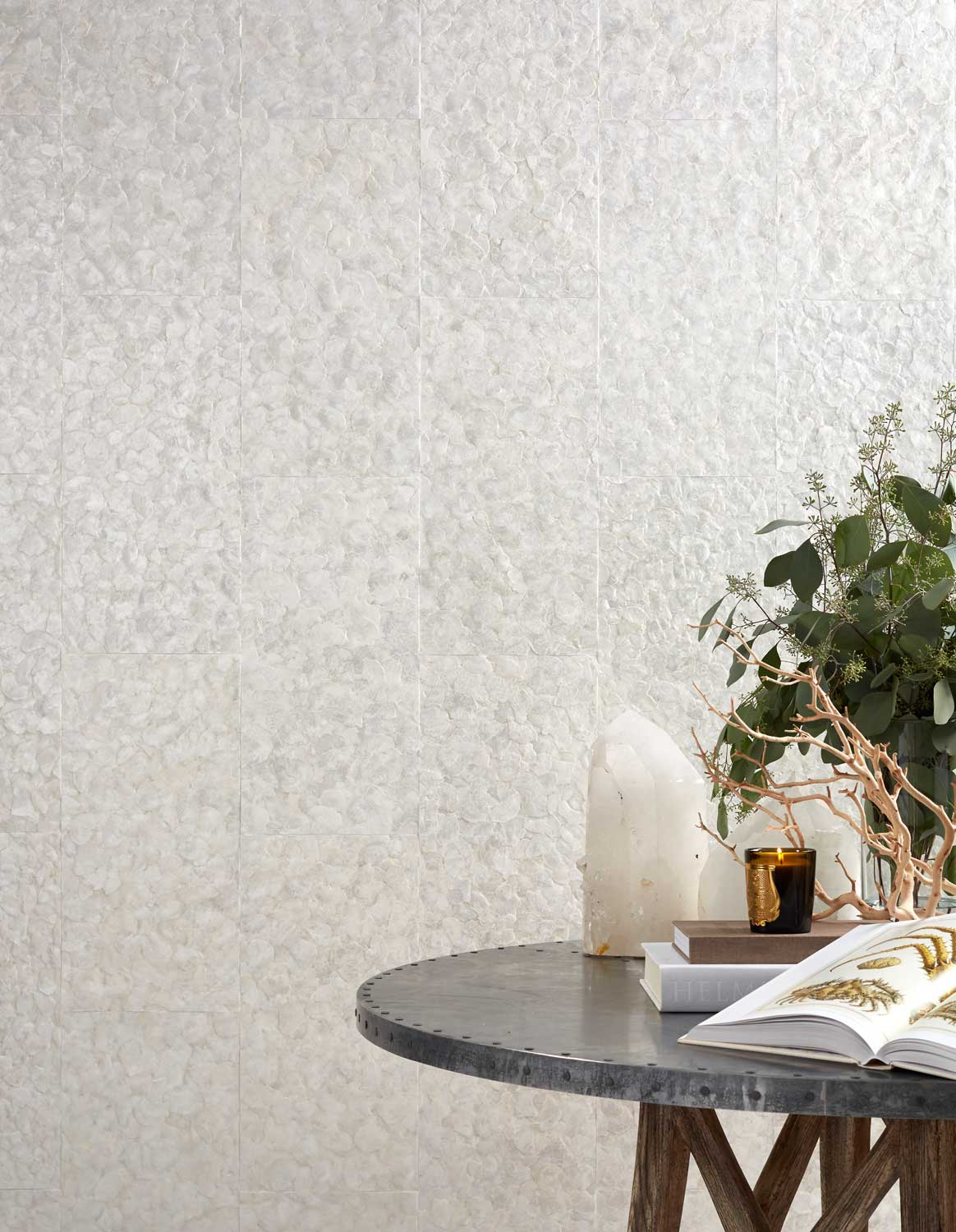 round table with plans and a white wallpaper on the wall
