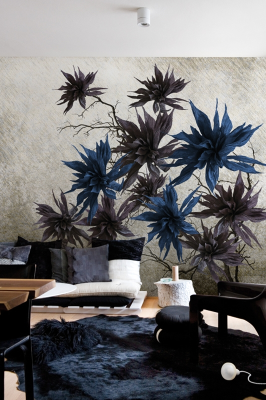blue and mauve flowers on a wallpaper wall