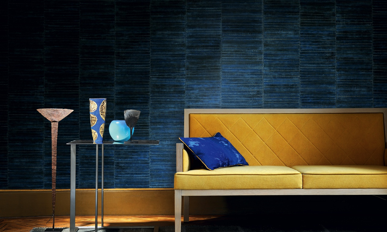dark blue wallpaper with a yellow sofa